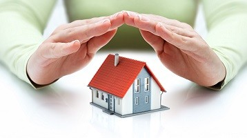 Hands over a home, symbolizing home insurance with Coast 2 Coast Insurance