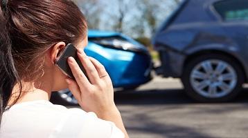 girl reporting a claim to destin based insurance company Coast 2 Coast Insurance
